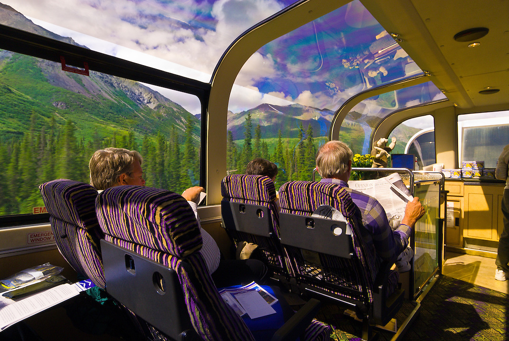 People aboard the Domed observation car of the Holland America McKinley Explorer railroad, Alaska