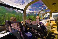People aboard the Domed observation car of the Holland America McKinley Explorer railroad, Alaska
