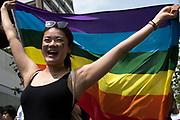 A participant holds a rainbow flag during the Rainbow Pride parade in Tokyo. Thousands of lesbians, gays, bisexuals, transgenders (LGBT) and their supporters participated in the parade on Sunday to celebrate LGBT lifestyle and denounce prejudice and discrimination against sexual minorities. Amnesty International Japan released a proposal Tuesday May 2, 2017 to the government on measures that the country must take to tackle discrimination against LGBT people: hiding one's sexual orientation or gender identity is still common, due to a fear of losing one's job or facing discrimination, both in the public and the private sector. On health, they asked the government to remove gender identity from the classification of mental diseases, to abolish inappropriate requirements for obtaining legal gender recognition, to educate medical experts, and to set certain health treatments required by transgender people to be covered by the national health insurance and public health systems. 07/05/2017-Tokyo, JAPAN