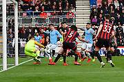 Artur Boruc (1) of AFC Bournemouth makes a save as John Stones (5) of Manchester City looks to score during the Premier League match between Bournemouth and Manchester City at the Vitality Stadium, Bournemouth, England on 2 March 2019.