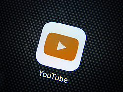 Youtube video streaming website app logo on screen of iPhone 6 plus smart phone