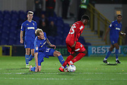 AFC Wimbledon midfielder Mitchell (Mitch) Pinnock (11) tackling Leyton Orient defender Shadrach Ogie (25) during the Leasing.com EFL Trophy match between AFC Wimbledon and Leyton Orient at the Cherry Red Records Stadium, Kingston, England on 8 October 2019.