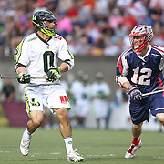 Albert Maione #0 of the New York Lizards keeps the ball away from Martin Bowes #12 of the Boston Cannons during the game at Harvard Stadium on July 19, 2014 in Boston, Massachusetts. (Photo by Elan Kawesch)