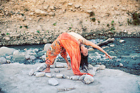 Woman in yoga pose by a flowing river.<br /> :::<br /> &quot;It seems that there's a difference between the critical mind, which is a kind of judgment, and has a harshness built in, cutting off impulses before they can develop, and discriminating intelligence, which can differentiate between what is authentic or genuine and what is contrived or forced.&quot;<br /> -Meredith Monk