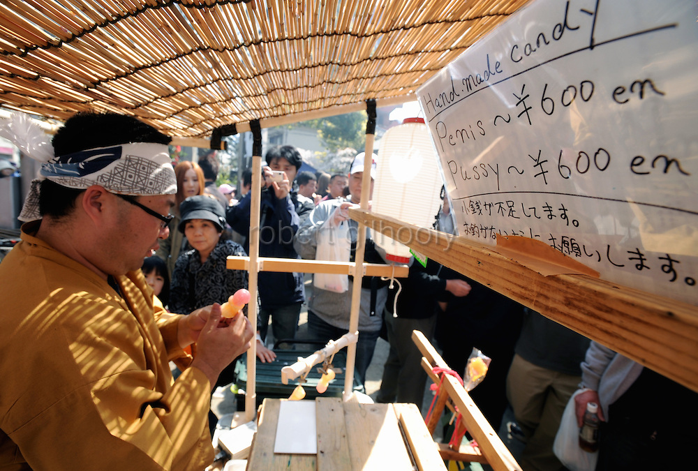 """A sells pallus-shaped lollipops at a stall during the Kanamara """"Penis"""" Festival in Kawasaki, Japan. Kanamara means metal phallus, so named after a story dating back hundreds of years in which a local blacksmith made an iron phallus to protect a girl who was thought to be curse. Today, the festival participants are largely prostitutes STDs."""