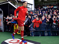 LONDON, ENGLAND - Sunday, March 17, 2019: Liverpool's Virgil van Dijk runs out for the the pre-match warm-up before the FA Premier League match between Fulham FC and Liverpool FC at Craven Cottage. (Pic by David Rawcliffe/Propaganda)