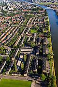 Nederland, Utrecht, Utrecht, 15-07-2012; de wijk Halve Maan, direct naast het Amsterdam-Rijnkanaal. De wijk maakt onderdeel van uit van het stadsdeel Oog en Al en stamt uit de  jaren vijftig, de wederopbouwperiode. Kenmerkend zijn laagbouw en portiek-flats. Onder in beeld Sportpark Marco van Basten, onder het midden Herderplein, Pnielkerk, boven het midden het Hugo de Grootplein..Halve Maan (Crescent) neighborhood, part of district Eye and Al. Low-rise flats and single-family houses. The neighborhood dates from the fifties, the post-war reconstruction period..luchtfoto (toeslag), aerial photo (additional fee required).foto/photo Siebe Swart