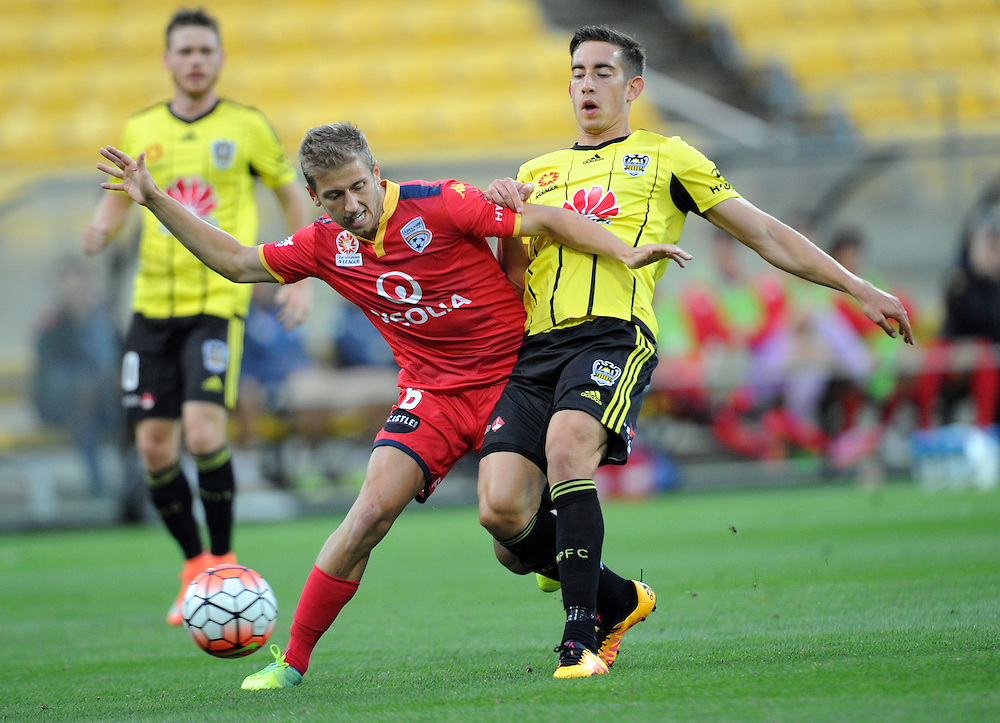 Adelaide United's Stefan Malik, left, contests the ball with Phoenix's Alex Rodriguez in the A-League football match at Westpac Stadium, Wellington, New Zealand, Saturday, March 05, 2016. Credit:SNPA / Ross Setford