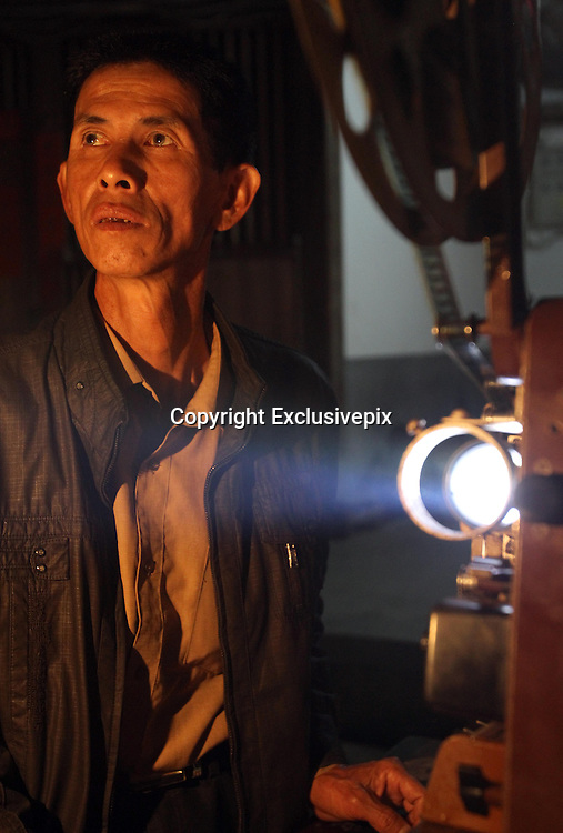 "ZHANGZHOU, CHINA - (CHINA OUT) <br /> <br /> ""Movie Theater"" In Rural China <br /> <br /> Movie projectionist Qiu Wensheng shows a movie for villagers in Zhangzhou, Fujian Province of China. There are many movie projectionists working in rural areas to show movies for farmers. <br /> ©Exclusivepix"