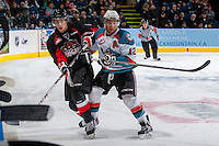 KELOWNA, CANADA -FEBRUARY 25: Tyrell Goulbourne #12 of the Kelowna Rockets checks a player of the Prince George Cougars during first period on February 25, 2014 at Prospera Place in Kelowna, British Columbia, Canada.   (Photo by Marissa Baecker/Getty Images)  *** Local Caption ***