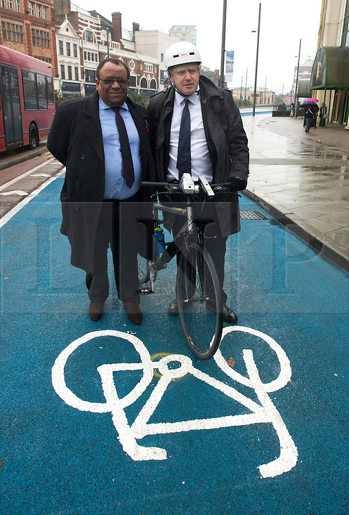 © Licensed to London News Pictures.06/11/2013. London, UK. Cllr Lester Hudson, Deputy Mayor of Newham and Boris Johnson, Mayor of London open London's first segregated section of Barclays Cycle Superhighway has been launched at Stratford High Street.Photo credit : Peter Kollanyi/LNP