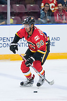 PENTICTON, CANADA - SEPTEMBER 16: Oliver Kylington #58 of Calgary Flames skates with the puck against the Winnipeg Jets on September 16, 2016 at the South Okanagan Event Centre in Penticton, British Columbia, Canada.  (Photo by Marissa Baecker/Shoot the Breeze)  *** Local Caption *** Oliver Kylington;