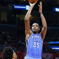 21 December 2015: Oklahoma City Thunder forward Kevin Durant (35) takes a jump shot over Los Angeles Clippers center DeAndre Jordan (6) during the Oklahoma City Thunder 100-99 victory over the Los Angeles Clippers, at the Staples Center, Los Angeles, California, USA.