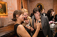 Actresses Rashida Jones, left, and Claire Danes, center, share a laugh at the Bloomberg Vanity Fair White House Correspondents' Association dinner afterparty at the residence of the French Ambassador on Saturday, April 28, 2012 in Washington, DC. Brendan Hoffman for the New York Times