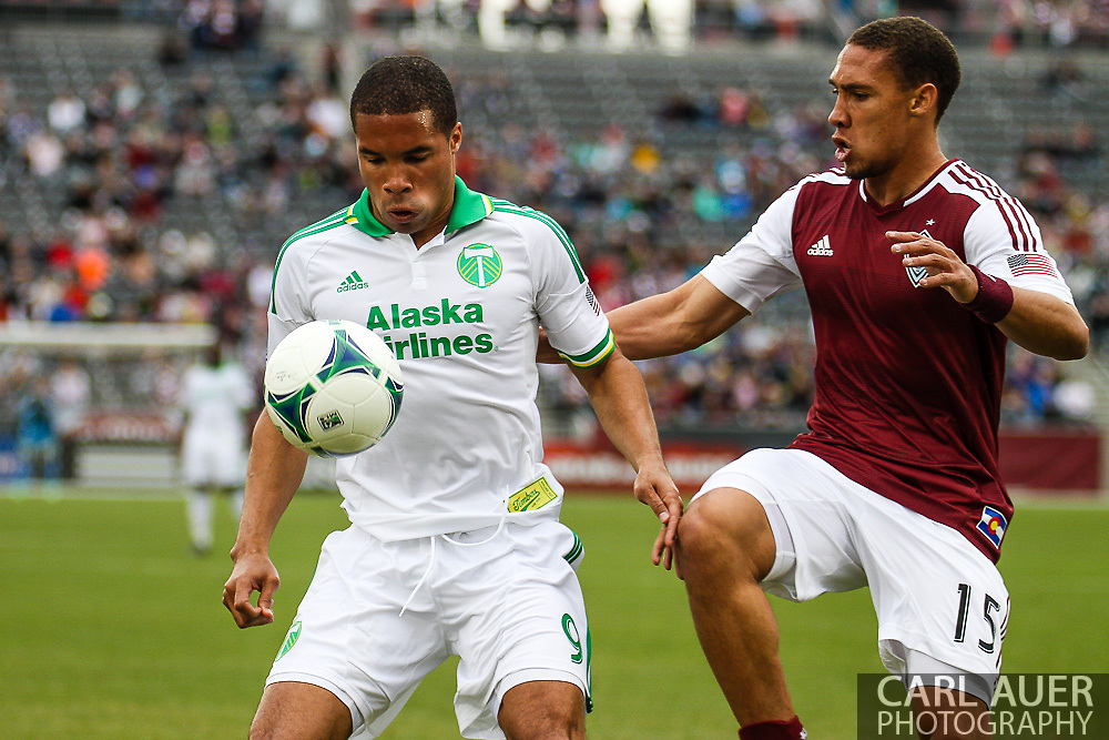 March 30th, 2013 Commerce City, CO - Portland Timbers forward Ryan Johnson (9) attempts to keep the ball away from Colorado Rapids defender Chris Klute (15) in the first half of the MLS match between the Portland Timbers and the Colorado Rapids at Dick's Sporting Goods Park in Commerce City, CO