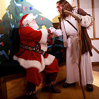 "Michael Grant, 28, ""Philly Jesus,"" greets Santa Claus at Macy's department store in Philadelphia, PA on December 18, 2014.  Nearly everyday for the last 8 months, Grant has dressed as Jesus Christ, and walked the streets of Philadelphia to share the Christian gospel by example.  He quickly acquired the nickname of ""Philly Jesus,"" which he has gone by ever since. REUTERS/Mark Makela (UNITED STATES)la (UNITED STATES)"