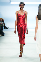 Amilna Estevão walks the runway wearing Cushnie et Ochs Fall 2016, hair by Antonio Corral Calero for Moroccanoil, makeup by Val Garland, photographed by Thomas Concordia during New York Fashion Week on February 12, 2016