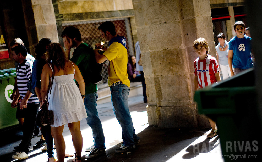 A boy wears an Athletic Bilbao football team's shirt in a street of the Northern Spanish Basque city of Bilbao, on August 25, 2011. Photo Rafa Rivas