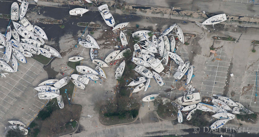 IN FLIGHT- AUGUST 30: Boats lie in a parking lot in the Lakeside area of New Orleans, Tuesday, August 30, 2005. .Over 100 people are feared dead and estimates put the property loss at nearly $30 billion as Hurricane Katrina could become the costliest storm in US history.<br />