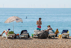© Licensed to London News Pictures. 07/08/2020. Brighton, UK. Members of the public take to the beach in Brighton And Hove as temperatures on the South Coast are expected to be the hottest of the year. Photo credit: Hugo Michiels/LNP