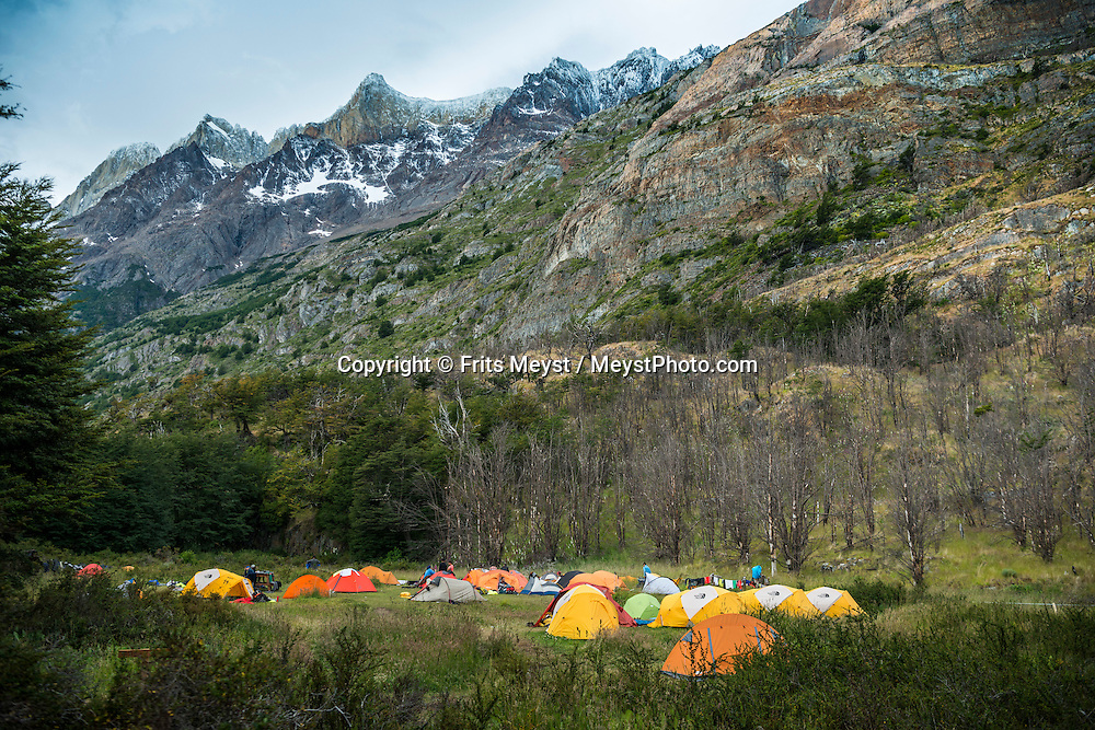 Patagonia, Chile, February 2016.  Tent camp at Refugio Vertice Grey on their way to the Grey Glacier Lookout. The most highly trekked route in Torres del Paine National Park is called the 'W'. This trail system can be done in a variety of ways, from more rugged camping style treks, to full room and board in refugios. The W Circuit is named after its trail system that navigates up and down out of the mountain valleys. Torres del Paine is a UNESCO World Biosphere Reserve and encompasses mountains, glaciers, lakes, and rivers in southern Chilean Patagonia. The Cordillera del Paine is the centerpiece of the park. It lies in a transition area between the Magellanic subpolar forests and the Patagonian Steppes. A 4x4 camper is one of the best vehicles to explore the wild interior of Southern Patagonia. Photo by Frits Meyst / MeystPhoto.com