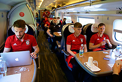 RUNCORN, ENGLAND - Tuesday, May 22, 2018: Wales' Tom Bradshaw, David Brooks and Tom Lockyer travel by train as the squad heads to Heathrow for a flight to Los Angeles ahead of the international friendly match against Mexico. (Pic by David Rawcliffe/Propaganda)