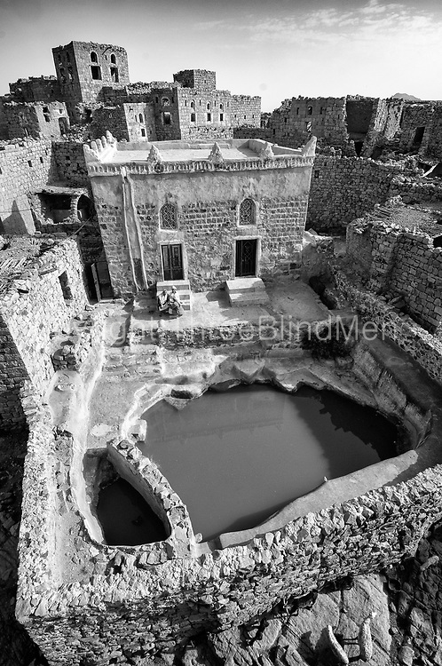 Yemen. <br /> Looking down on a delightful Mosque in Bait Bus. Photographed from the roof of a house.<br /> 2007