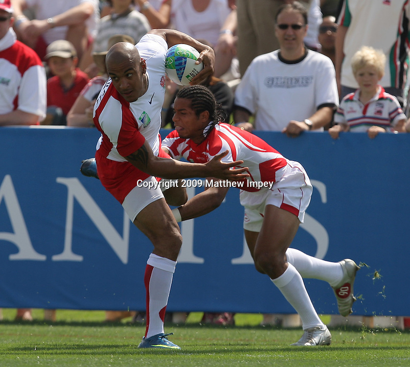 Tom Varndell of England gets away from Sabari Guemir of Tunisia. IRB World Cup Sevens, Dubai, Day 2 06/03/2009 © Matthew Impey/Wiredphotos.co.uk. tel: 07789 130 347 email: matt@wiredphotos.co.uk