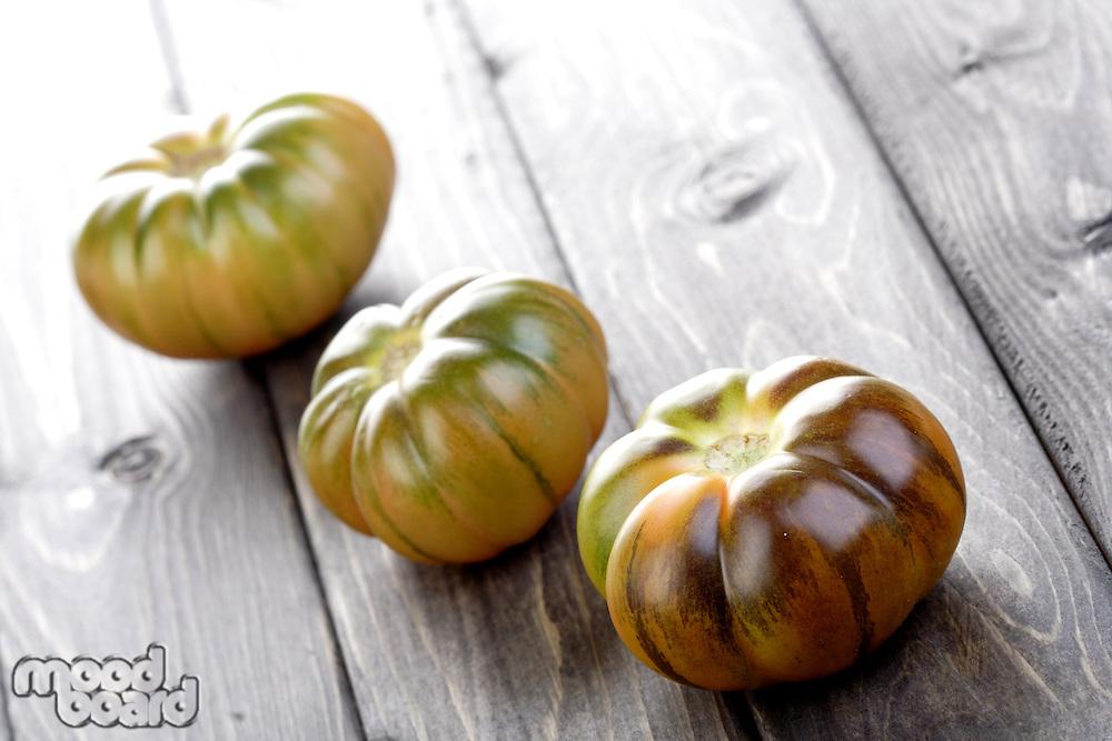 Studio shot of black tomatoes on white bacground