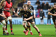 Wasps back row Jack Willis (7) runs with the ball during the Gallagher Premiership Rugby match between Wasps and Saracens at the Ricoh Arena, Coventry, England on 21 February 2020.