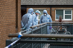 © Licensed to London News Pictures. 04/07/2020. London, UK. Forensic investigators search for evidence at a block of flats on Westbourne Estate in Islington. Metropolitan Police Service officers were called at 15:20BST on Saturday, 4 July to Roman Way N7 following reports of shots fired. Officers attended with London Ambulance Service (LAS) and found a man, believed to be aged in his early 20s, suffering from gunshot injuries. Despite their best efforts, he was pronounced dead at the scene. Photo credit: Peter Manning/LNP