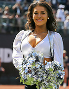 Sep 30, 2018; Oakland, CA, USA;  A Raiderette cheerleader prior to a game between the Oakland Raiders and the Cleveland Browns. The Raiders defeated the Browns 45-42 in overtime. Mandatory Credit: Spencer Allen-Image of Sport