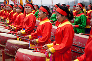 A group of vietnamese women play drums at buffalo painting festival close Phu Ly, Vietnam, Asia