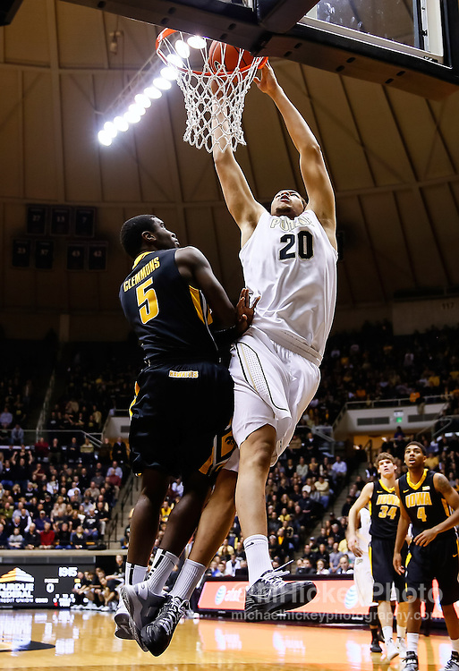 WEST LAFAYETTE, IN - JANUARY 27: A.J. Hammons #20 of the Purdue Boilermakers goes up for a dunk against Anthony Clemmons #5 of the Iowa Hawkeyes at Mackey Arena on January 27, 2013 in West Lafayette, Indiana. (Photo by Michael Hickey/Getty Images) *** Local Caption *** A.J. Hammons; Anthony Clemmons