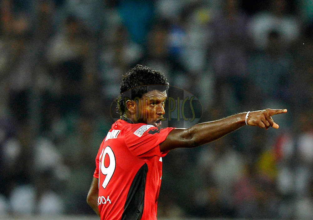 Ruhunu Eleven player Arosh Janoda celebrates after getting a wicket during the Q1 match between Trinidad & Tobago and Ruhunu Eleven held at the Rajiv Gandhi International Stadium, Hyderabad on the 19th September 2011..Photo by Vipin Pawar/BCCI/SPORTZPICS