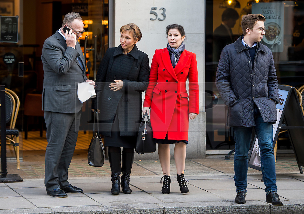 """©  London News Pictures. 28/01/2016. London, UK. MARINA LITVINENKO (second left), wife of murdered Russian agent Alexander Litvinenko, arrives at The Home Office in London with her son ANATOLY (right) and lawyer, BEN EMMERSON QC (far left)  ahead of private talks with British home secretary Theresa May. The meeting comes a week after an official inquiry into her husband's death concluded that his killing was """"probably approved"""" by Russian president Vladimir Putin. Photo credit: Ben Cawthra/LNP"""