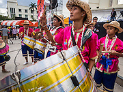 "15 NOVEMBER 2013 - BANGKOK, THAILAND: Students dressed in traditional Thai outfits march into the protest venue during an anti-government protest in Bangkok. Tens of thousands of Thais packed the area around Democracy Monument in the old part of Bangkok Friday night to protest against efforts by the ruling Pheu Thai party to pass an amnesty bill that could lead to the return of former Prime Minister Thaksin Shinawatra. Protest leader and former Deputy Prime Minister Suthep Thaugsuban announced an all-out drive to eradicate the ""Thaksin regime."" The protest Friday was the biggest since the amnesty bill issue percolated back into the public consciousness. The anti-government protesters have vowed to continue their protests even though the Thai Senate voted down the bill, thus killing it for at least six months.     PHOTO BY JACK KURTZ"
