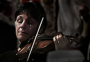 Violinist Nancy DiNovo plays during a memorial service at Christchurch Cathedral for those killed following the 9/11 attack in New York. Vancouver, BC.  (2001)