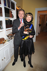 SIR CHRISTOPHER & LADY MEYER at a birthday party for Lady Meyer hosted by Richard & Basia Briggs at their home 25 Sloane Gardens, London SW1 on 28th January 2009.