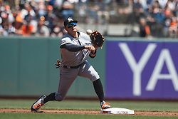 SAN FRANCISCO, CA - APRIL 24: Miguel Rojas #19 of the Miami Marlins throws to first base to complete a double play against the San Francisco Giants during the first inning at AT&T Park on April 24, 2016 in San Francisco, California.  (Photo by Jason O. Watson/Getty Images) *** Local Caption *** Miguel Rojas