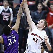 Scott Eatherton #43 of the Northeastern Huskies and Taylor Bessick #22 of the James Madison University Dukes fight for a ball during the game at Matthews Arena on January 29, 2014 in Boston, Massachusetts . (Photo by Elan Kawesch)