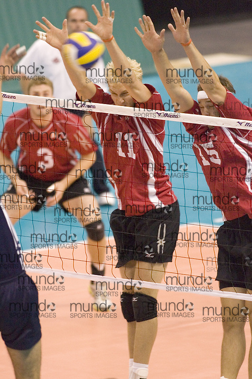 Steve Brinkman (11) and Fred Winters (15) blocking as Tunisia defeats Canada three games to two in the 2006 Anton Furlani Volleyball Cup. .Copyright Sean Burges / Mundo Sport Images, 2006 .Anton Furlani Cup.Copyright Sean Burges / Mundo Sport Images, 2006