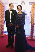 April 10, 2016 - Mumbai, INDIA - <br /> <br /> Britain's Prince William, and his wife, Kate, the Duchess of Cambridge, pose after they arrive for a charity ball at the Taj Mahal Palace hotel  in Mumbai, India, Sunday, April 10, 2016. The royal couple began their weeklong visit to India and Bhutan, by laying a wreath at a memorial Sunday at Mumbai Taj Mahal Palace hotel, where 31 victims of the 2008 Mumbai terrorist attacks were killed.<br /> ©Exclusivepix Media