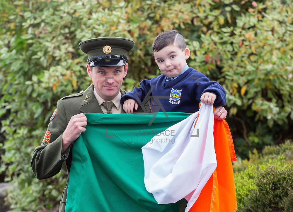 23/10/2015       <br /> Members of the Defence Forces were in Abbeyfeale today to present a handmade Tricolour and a copy of the Proclamation of the Irish Republic to students of the town's two primary schools.<br /> <br /> St Marys Boys National School and Scoil Mh&aacute;thair D&eacute; are among 3,000 schools nationally and 152 Limerick primary schools to receive the presentation as part of initiatives to mark the centenary of the 1916 Rising.&nbsp;<br /> <br /> Councillor Liam Galvin, Mayor of the City and County of Limerick joined pupils and teachers for today's presentation ceremony, which saw representatives of the Defences Forces raise the flag and read the Proclamation. <br /> <br /> Attending the ceremony at St. Marys Boys National School were, Sergeant James Reddan handing over the Tricolour to 4 year old pupil Dillon O'Brien. Picture: Alan Place.