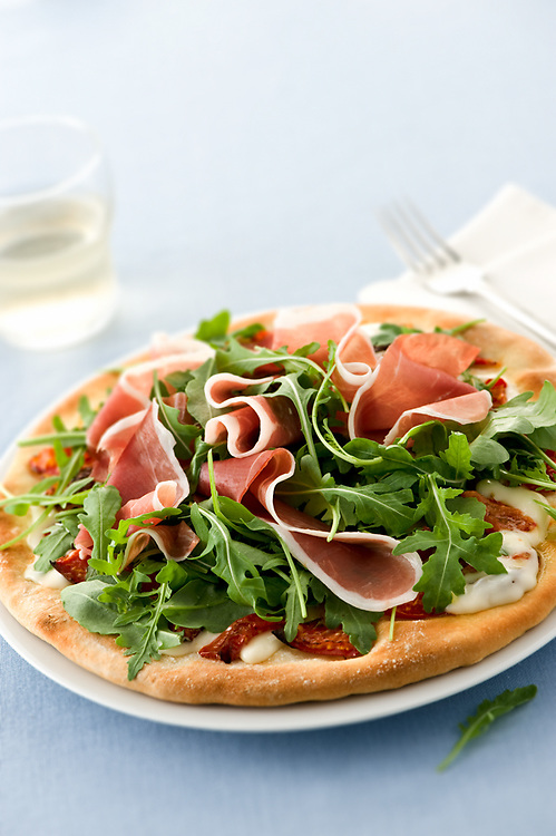 rocket salad and ham pizza