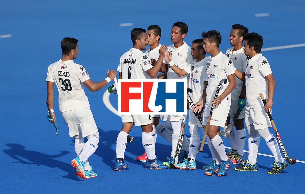 LONDON, ENGLAND - JUNE 20:  Razie Rahim of Malaysia celerates scoring his sides fourth goal with his Malaysia team mates during the Pool A match between China and Malaysia on day six of the Hero Hockey World League Semi-Final at Lee Valley Hockey and Tennis Centre on June 20, 2017 in London, England.  (Photo by Alex Morton/Getty Images)
