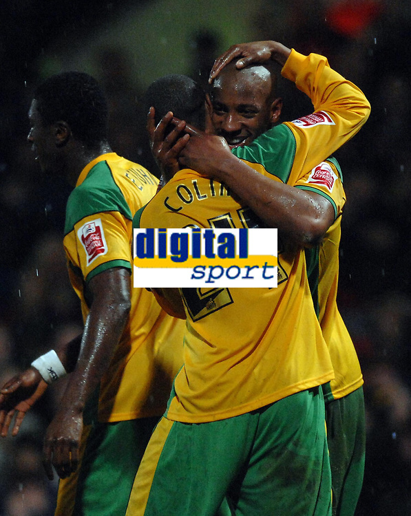 Photo: Ashley Pickering.<br />Norwich City v Queens Park Rangers. Coca Cola Championship. 30/12/2006.<br />Dion Dublin (R) is congratulated after scoring Norwich's winning goal