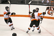 RIT players celebrate a third period goal by RIT's Lindsay Stenason during a game against Union College at the Gene Polisseni Center on October 3, 2014.