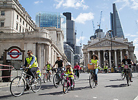 Riders pass the Royal Exchange and Bank Tube Station as part of the Prudential RideLondon FreeCycle29/07/2017.<br />