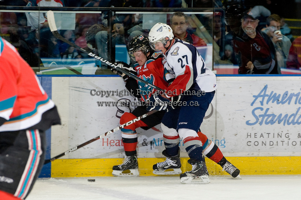 KELOWNA, CANADA, NOVEMBER 30: Shane McColgan #18 of the Kelowna Rockets is checked by Connor Rankin #27 of the Tri City Americans as the Tri City Americans visit the Kelowna Rockets  on November 30, 2011 at Prospera Place in Kelowna, British Columbia, Canada (Photo by Marissa Baecker/Shoot the Breeze) *** Local Caption *** Shane McColgan;Connor Rankin;